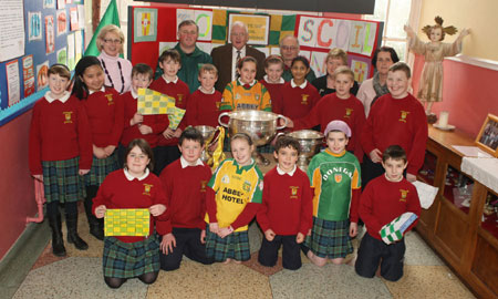 Pupils from Scoil Catriona National School, Ballyshannon pictured with the Sam Maguire, Tom Markham (All-Ireland minor football championship) and McKenna cups when they visited their school last Friday.