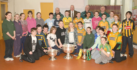 Senior pupils from Rockfield National School, Ballyshannon pictured with the Sam Maguire, Tom Markham (All-Ireland minor football championship) and McKenna cups when they visited their school last Friday.