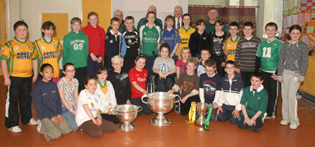 Pupils from Creevy National School, Ballyshannon pictured with the Sam Maguire, Tom Markham (All-Ireland minor football championship) and McKenna cups when they visited their school last Friday..