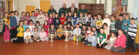 Pupils from Creevy National School, Ballyshannon pictured with the Sam Maguire, Tom Markham (All-Ireland minor football championship) and McKenna cups when they visited their school last Friday.