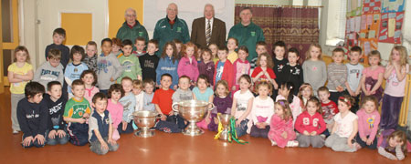 Pupils from Creevy NS School, Ballyshannon pictured with the Sam Maguire, Tom Markham (All-Ireland minor football championship) and McKenna cups when they visited their school last Friday.