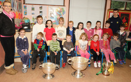 Pupils from Rockfield National School, Ballyshannon pictured with the Sam Maguire, Tom Markham (All-Ireland minor football championship) and McKenna cups when they visited their school last Friday. Also pictured is Donegal and Aodh Ruadh player former pupil Johnny Gallagher.