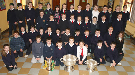 Senior clases from Holy Family National School, Ballyshannon pictured with the Sam Maguire, Tom Markham (All-Ireland minor football championship) and McKenna cups when they visited their school last Friday.