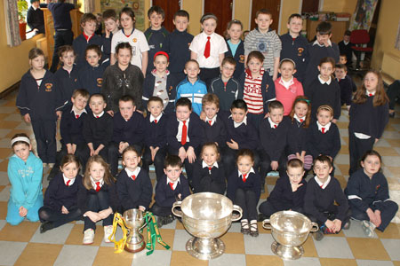 Pupils from Holy Family National School, Ballyshannon pictured with the Sam Maguire, Tom Markham (All-Ireland minor football championship) and McKenna cups when they visited their school last Friday.