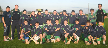 Aodh Ruadh under 12 hurlers with Peter Horan, manager, John Rooney, selector, and Packie McGrath of McGrath's Bouncy Castles, sponsors of the teams new tracksuits.
