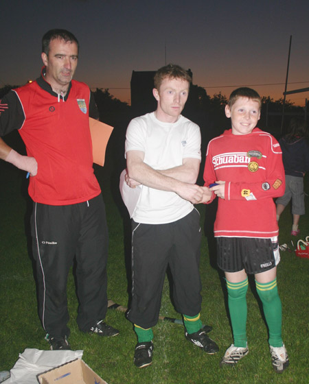 Peter Horan presents Jamie Brennan with his medal for coming second in the under 12 skills competition.
