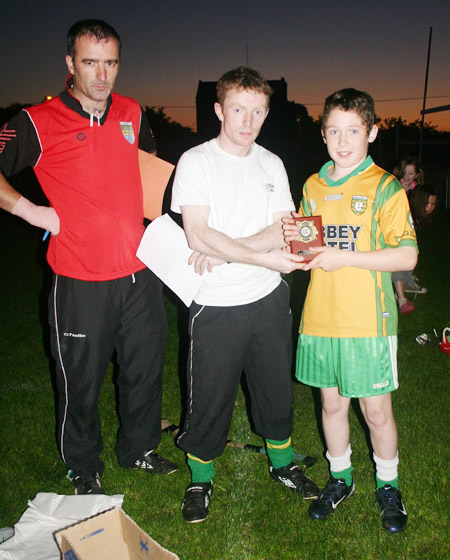 Peter Horan presenting Eddie Lynch with his award for winning the under 12 skills competition.