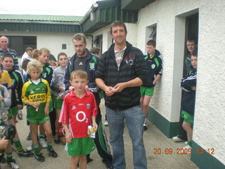 Michael Ayres, under 10 joint manager, presenting Liam O'Sullivan, fifth in the under 10 section with his medal.