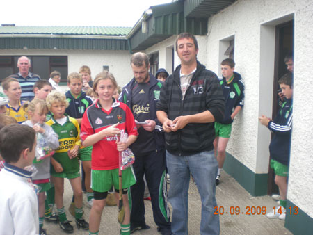 Michael Ayres, under 10 joint manager, presenting Méabh Rooney, fourth in the under 10 section with his medal.