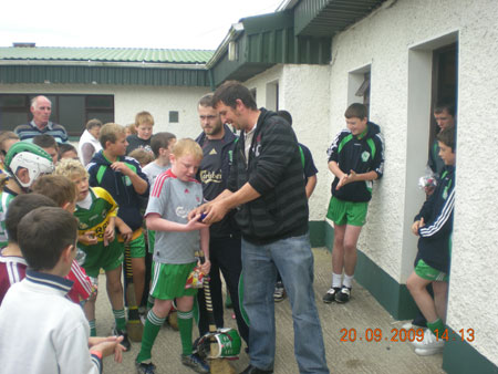 Michael Ayres, under 10 joint manager, presenting Barry Kelly, first in the under 10 section with his medal.