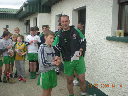 John Rooney, under 12 manager, presenting Ciaran Kelly, second in the under 12 section with his medal.