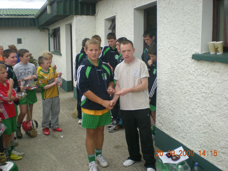 Peter Horan, under 14 manager, presenting Shane Mulhern, fifth in the under 14 section with his medal.