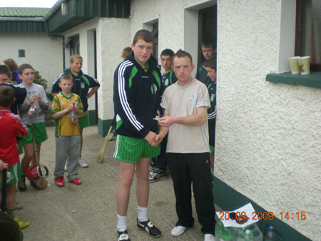 Peter Horan, under 14 manager, presenting Eamon McGrath, fourth in the under 14 section with his medal.