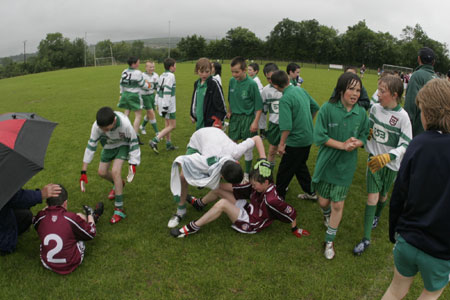 Aodh Ruadh players console their Termon counterparts after the final whistle.