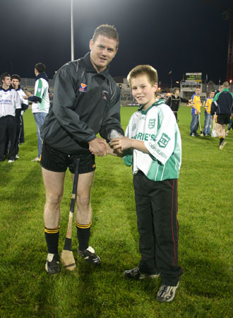 Ulster player, Paddy McArdle, presents Aodh Ruadh under 12 captain, Tommy Gillespie with his medal at the interprovincial games in McCumhaill Park, Ballybofey.