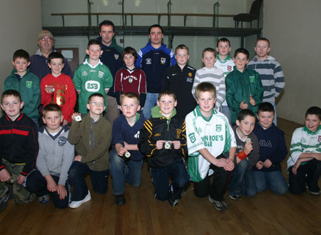 Alan Kerins, Galway senior hurling star, presenting Aodh Ruadh under 12 hurlers with their county medals after the M. Donnelly interprovincial matches between Ulster and Connacht in Ballybofey on Saturday, 20th October.