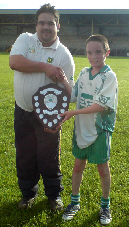 Rory McGonigle, Donegal Hurling Chairman, presenting the County Shield to the victorious Aodh Ruadh Captain, Donal O'Keefe.