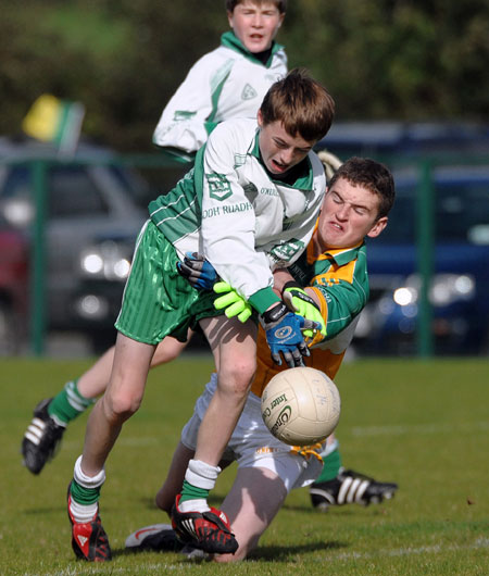 Aodh Ruadh's David McGurrin tussles with Buncrana's Stephen Nelson during Saturday's final.