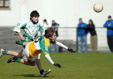 Buncrana's Darrach O'Connor goes flying under a strong challenge during Saturday's final.