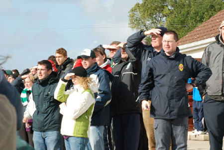 The Aodh Ruadh faithful watch anxiously.