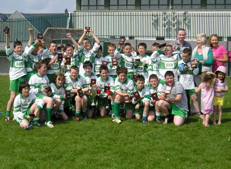 Aodh Ruadh celebrate after victory in the Willie Rogers under 12 tournament in Ballyshannon last Saturday.